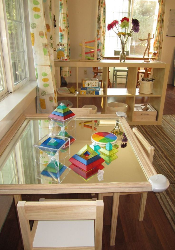 Great idea for play - have a mirror table top for kids to create on. Great play room with the mirror table.