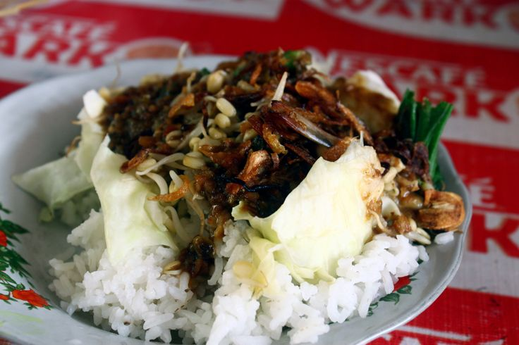 Nasi pecel, this is cooked vegetables mixed with peanut sauce rice. Ingredients simple but  sauce particular.