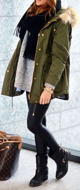 Woman wearing black leather tights and green parka