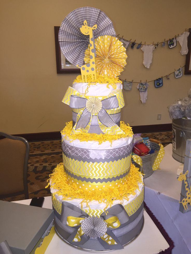 Check out Gray and yellow diaper cake for child bathe....might be unisex... Pinwheel decor.....