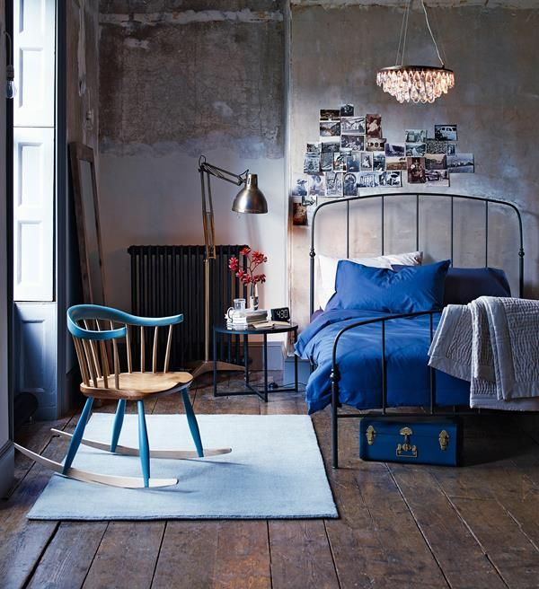 I like the rough textured wall, the collage, and the addition of blue as accent colours