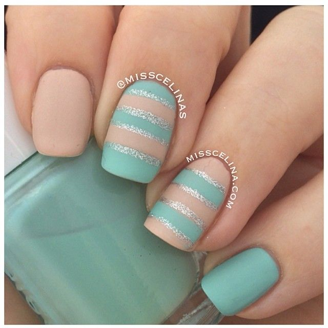 For the middle finger/ring finger design, paint a base coat of either tan or light blue. Then use the tape technique w/ straight across stripes to do the opposite color. Then using a striping nail polish (silver glitter), do outlines.
