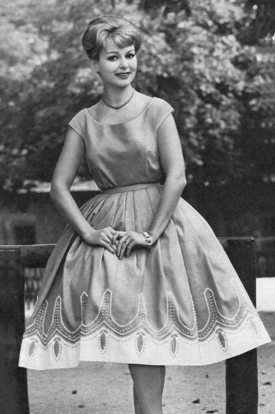 """A voluminous """"circle"""" skirt made possible by its A-line flare and a layer of tulle or crinoline below."""