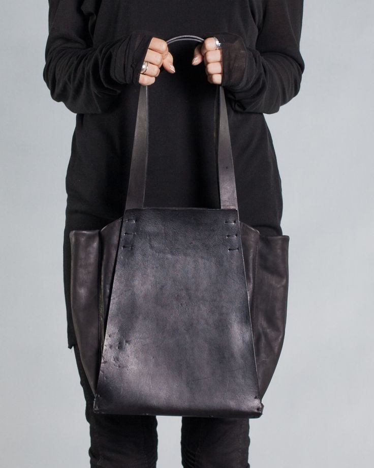 Washed leather tote bag 019Y - black – by independent designer ytn7, €511 at Vathir.com   Large hand dyed and washed leather tote bag - Large main compartment lined with an off black cotton - Single interior pocket - Stiff belt leather for the carcass and handles - Large stitch details - Magnetic closure to the main compartment - Due to the nature of this product inconsistencies are expected revered  Delivered in a linen bag  Only handcraft