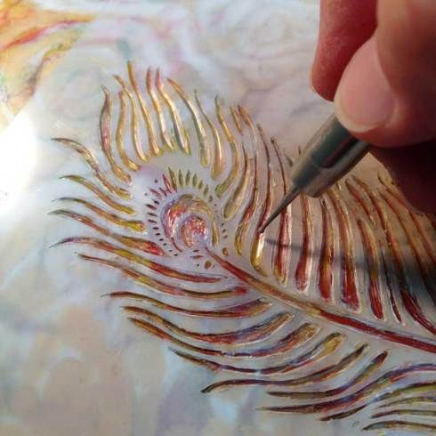 03-carve   I let the wax cool and firm up a bit then I found just the right spot for this feather stencil, also from StenciGirl and desiged by Kae Pea. I used the stylus tool to carve out the pattern, revealing colors that were already on the board underneath my last coat of wax paint. Don't fool yourself, this takes some patience, but the results are totally worth it!