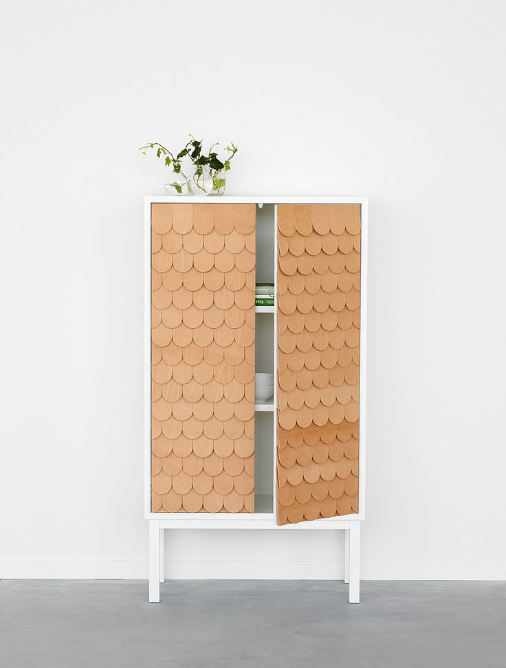 Cabinet with leather tiles by Swedish designer Sara Larsson - I WANT THIS MORE THAN ANYTHING IN LIFE.