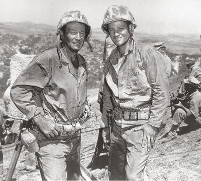 John Wayne & WW2 Marine Veteran John Bradley - The Duke never served in the military, but spent a lot of time in combat zones supporting our troops. BTW, a lot of GIs signed up because of what they saw on the screen from this All-American hero!