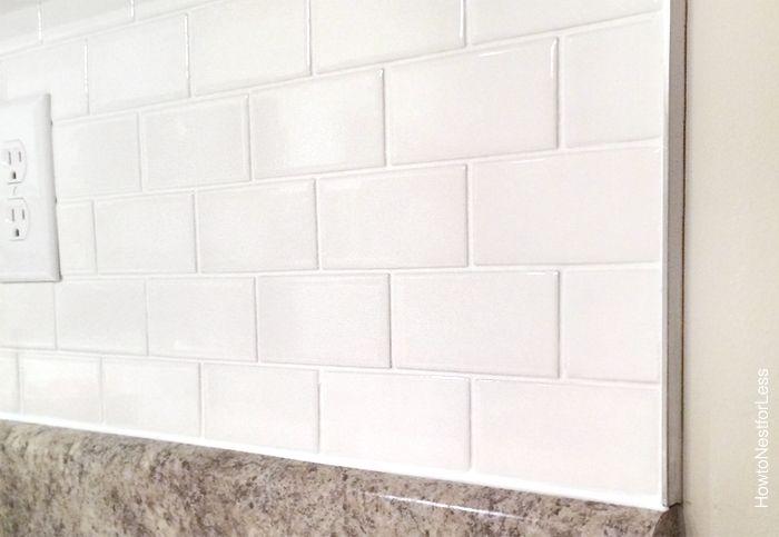kitchen white subway tile backsplash http://howtonestforless.com/2014/10/14/install-kitchen-backsplash/