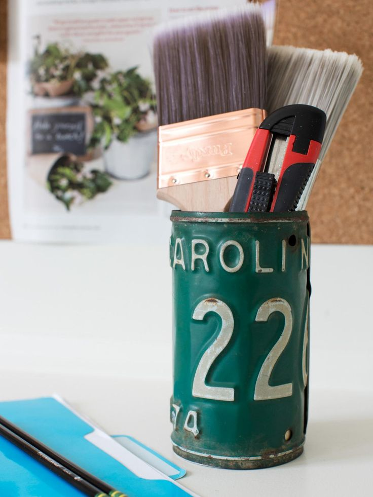 Add stylish storage to a workspace with a vintage tool holder. Made from old license plates or thin sheet metal, the vessel is constructed by wrapping the metal material around a small emptied tuna fish can, then fastening the ends together with rivets or using a soldering gun