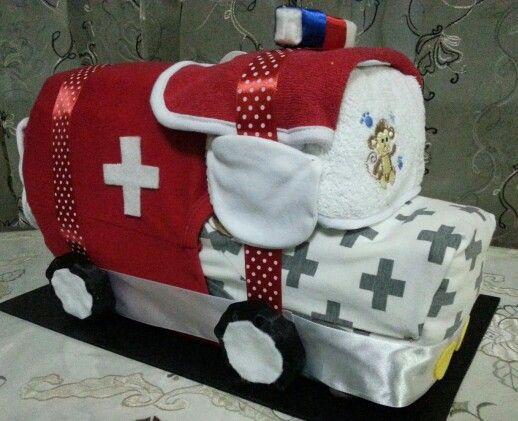 Ambulance Diaper Cake. Nice gift for baby shower!  Visit our Facebook page - www.facebook.com/INDAs.Crafts