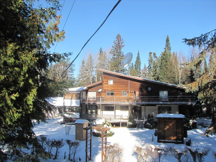 Ontario Cottage Resort and Cottage Rentals in Kearney, Ontario.  Enjoy winter escapes, snowmobiling, snow shoeing, cross country skiing, tubing, ice skating, ice fishing, down hill skiing and relaxing in a hot tub and sitting beside a cozy wood stove or fireplace.