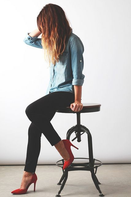 denim shirt, black skinny, red heel.