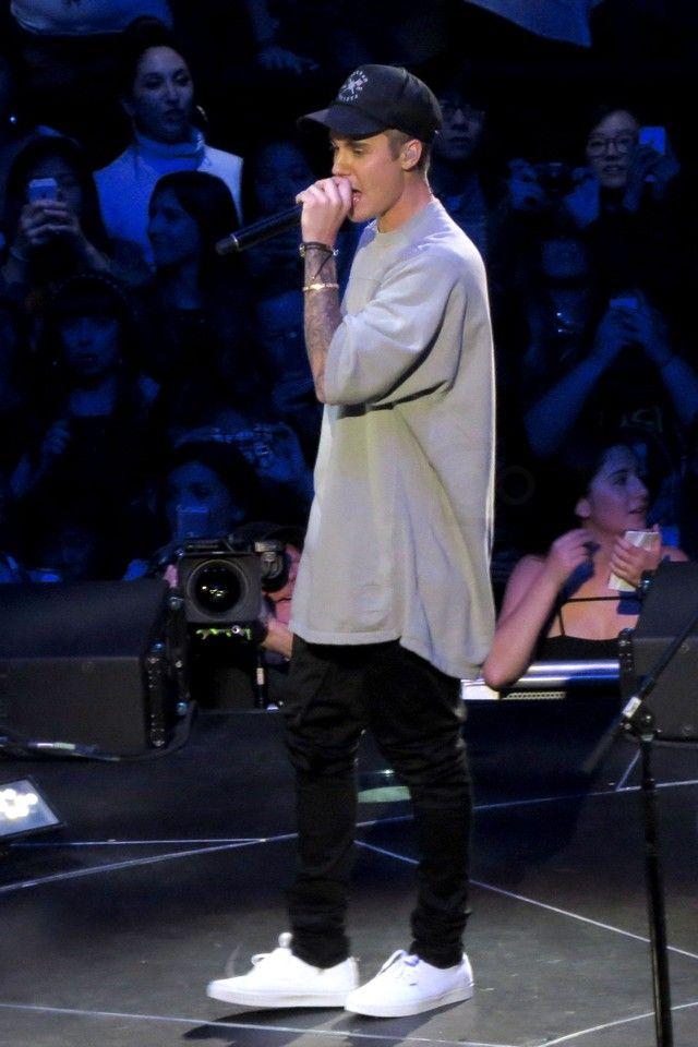 Justin Bieber wearing Cartier 18 Carat Yellow Gold And Diamond Love Bracelet , Freedom Artists Seal Snapback, Vans Authentic Sneaker, Monica Vinader Linear Large Friendship Bracelet, Rick Owens Jumbo Oversize T-Shirt