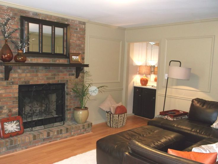 HUGE family room with cozy fireplace  wet bar Painted judges paneling adds that extra touch to