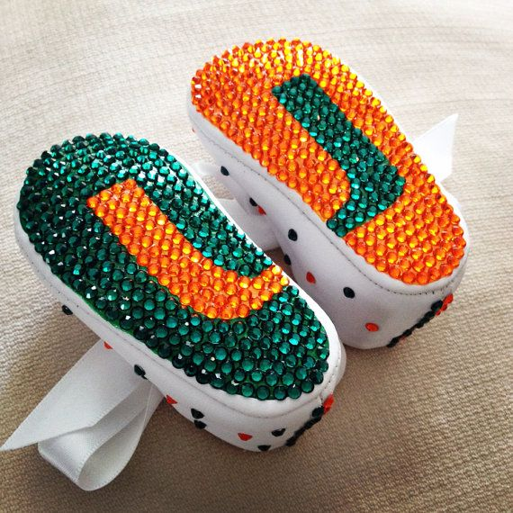 University of Miami Hurricanes Crystal baby crib shoes. Completely necessary!