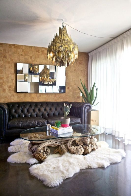 Furry rug, driftwood table & corkboard wall