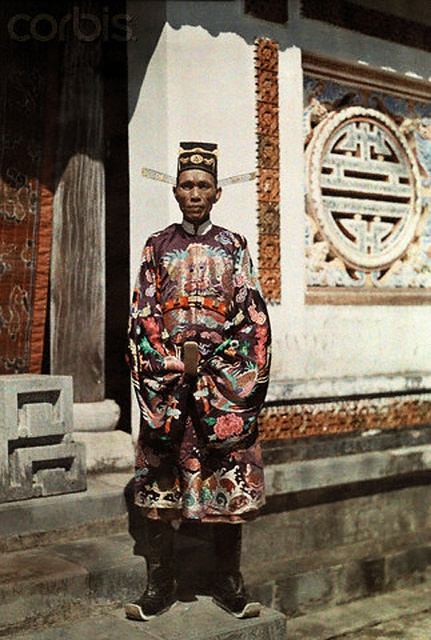 1931, Annam, Vietnam --- A civil mandarin poses in his winged scholar's bonnet --- Image by © W. Robert Moore/National Geographic Society/Corbis