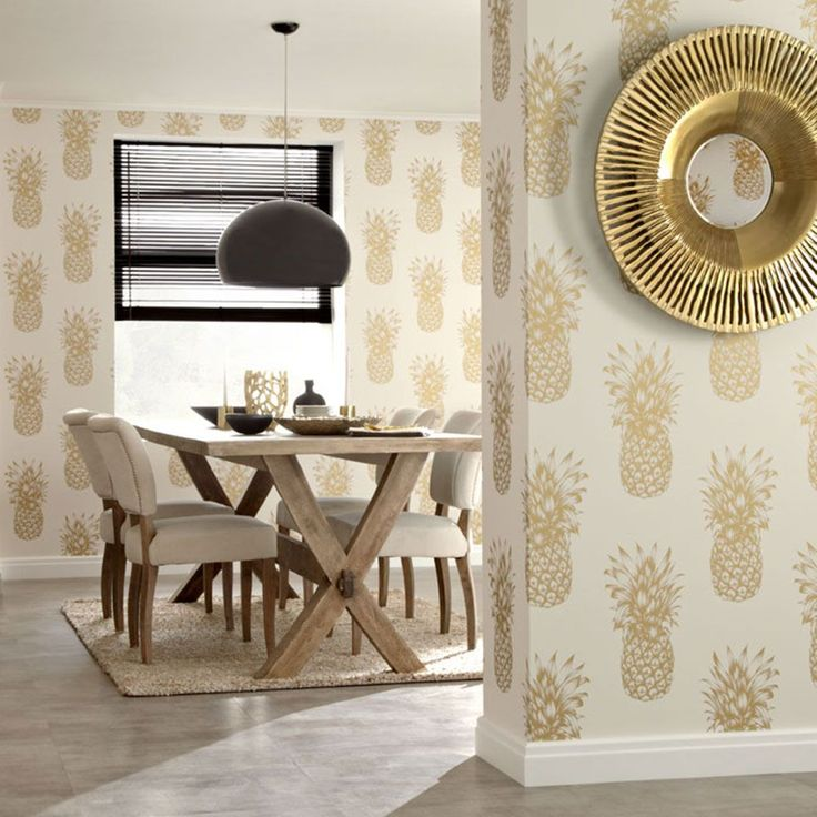 Tropics Copacabana Pineapple Wallpaper - Gold - Arthouse 690901  This beautiful Copacobana Pineapple wallpaper features a large illustrated style gold pineapple motif, with a subtle metallic finish for added effect, in a repeat pattern on a soft cream background. Easy to apply, this high quality wallpaper would look great as a feature wall or equally good when used to decorate a whole room. A beautiful pineapple themed wallpaper Features subtle metallic highlights Ideal for bedrooms and…