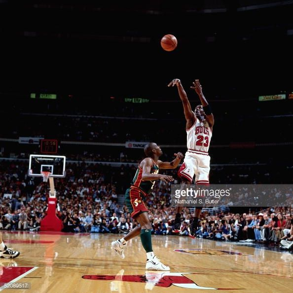 Michael Jordan of the Chicago Bulls shoots a jump shot against the Seattle Sonics during Game six of the 1996 NBA Finals at United Center on June 16...
