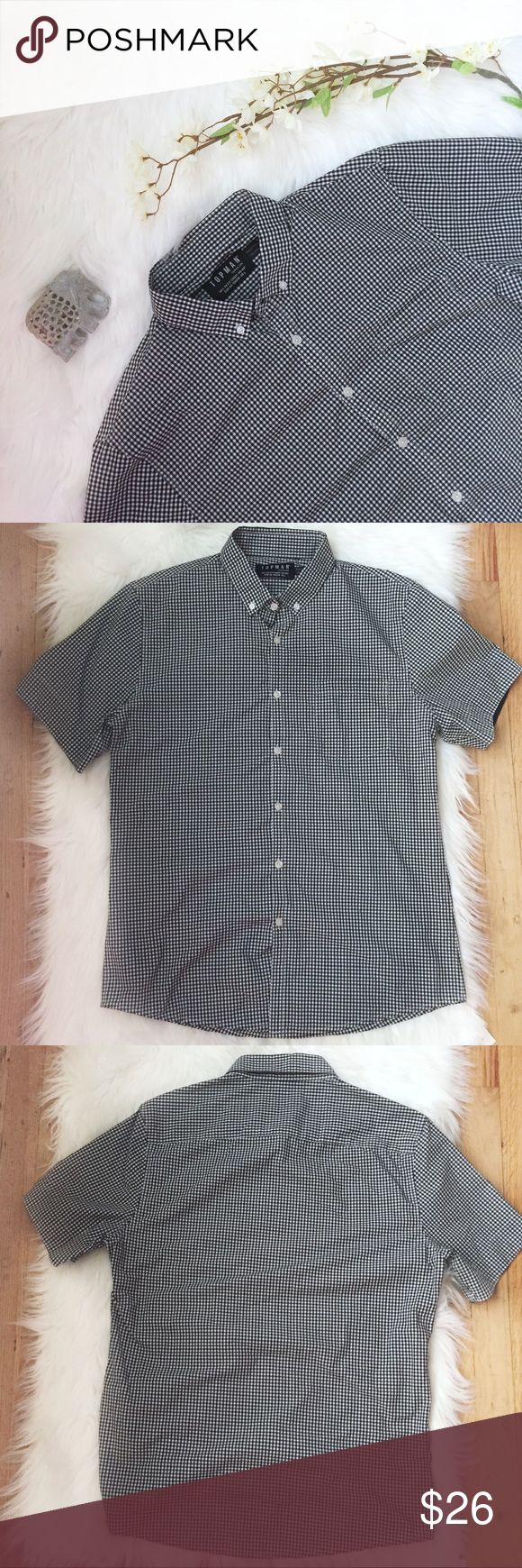 Topman Gingham Plaid Short Sleeve Button Up Shirt Preowned Topman Short sleeve button down front gingham / plaid print Can roll up the sleeves Color: Black and White Gently used condition with no stains or holes Size: Large See pictures for fabric content and approximately measurements while flat, unstretched  Feel free to make an offer or bundle & save! Topman Shirts Casual Button Down Shirts