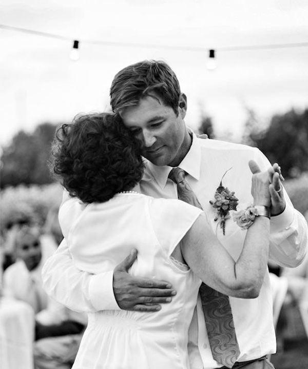 It's not all about the bride -- the groom's got to have a picture of the mother/son dance! songs/