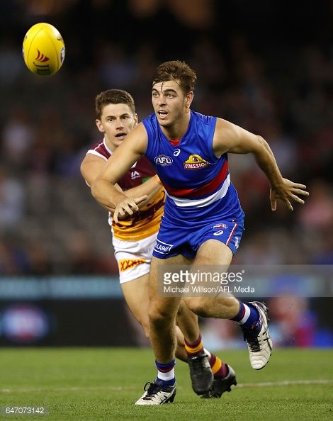 Declan Hamilton of the Bulldogs and Dayne Zorko of the Lions compete for the ball during the AFL 2017 JLT Community Series match between the Western...