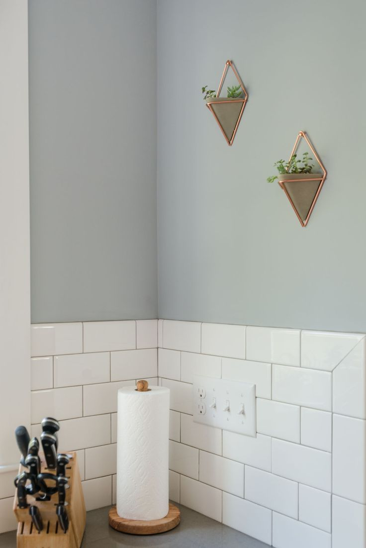 We love this classic, neutral gray paint and subway tile back splash combination.