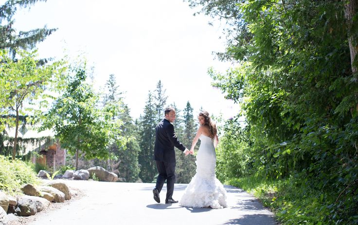 McMichael Art Museum wedding, bride and groom walking