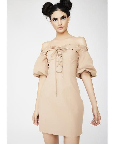 I AM GIA Alya Dress cuz you got a lil attitude. This tan dress has an off-shoulder lace-up neckline, puffy sleeves, and a slim but comfy fit.