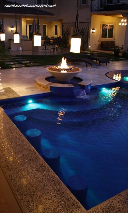 Love the fire pit by the pool and the built-in stools.