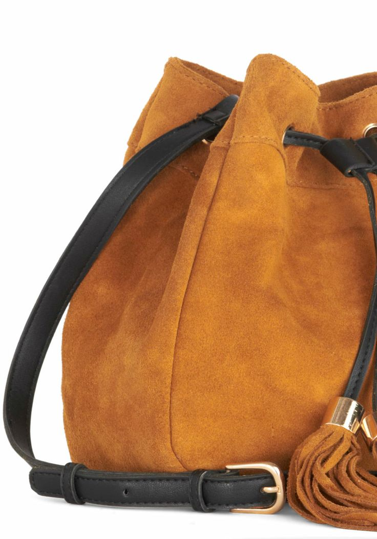 Wild, Wild West Coast Bag. As you lay eyes on the Pacific for the first time, you reach a hand into this suede shoulder bag and pull your camera out to capture the sun setting over the water. #tan #modcloth
