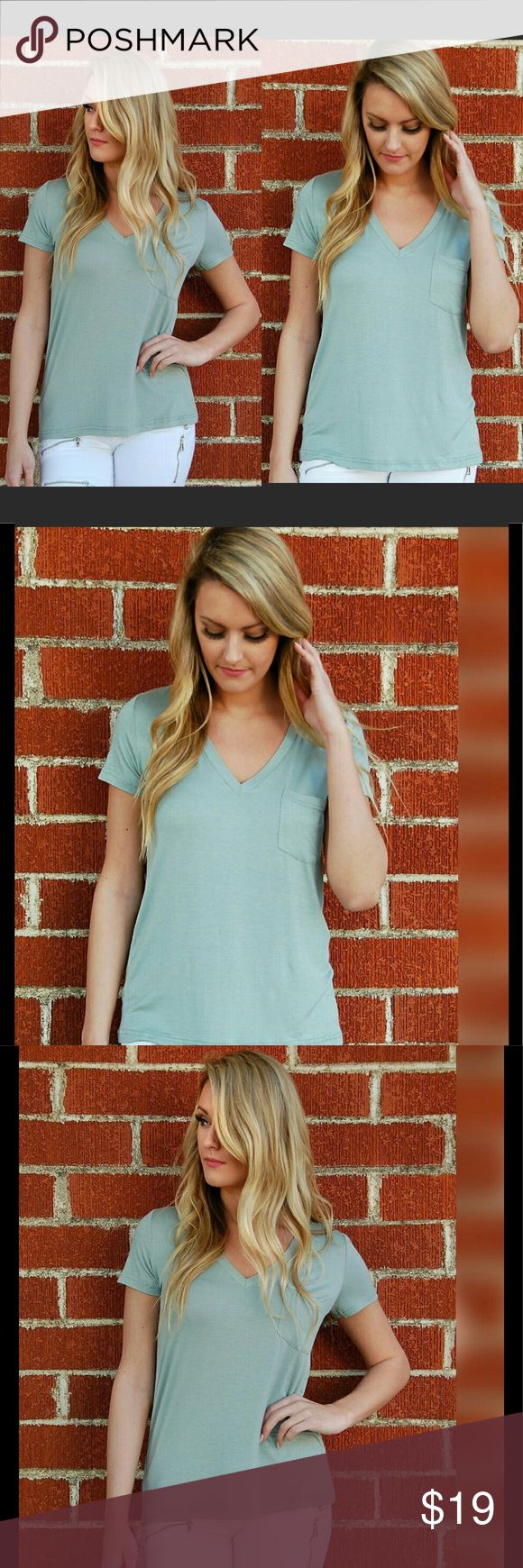 "Basic pocket top in sage Super soft jersey tee with pocket detail.   Sage green   Must have closet staple is the basic t-shirt.    95% Rayon 5% Spandex   Sizes XS-XL. True to size   Model is 5""7 and is wearing a small Tops Tees - Short Sleeve"