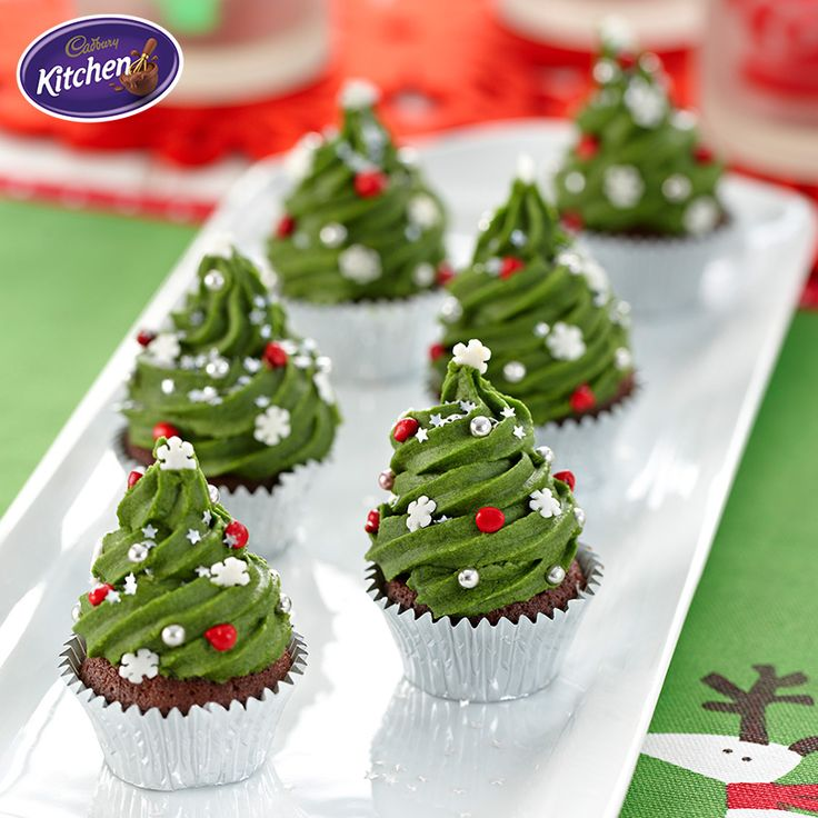 Are you a fan of white or dark chocolate? These Christmas Tree Mini Mud Cakes mix CADBURY White Chocolate Melts with CADBURY Dark Baking Chocolate, so everyone will be happy  this Christmas.  #desserts #cake #baking #chocolate #mudcake #CADBURY #christmasrecipes #bakingrecipe