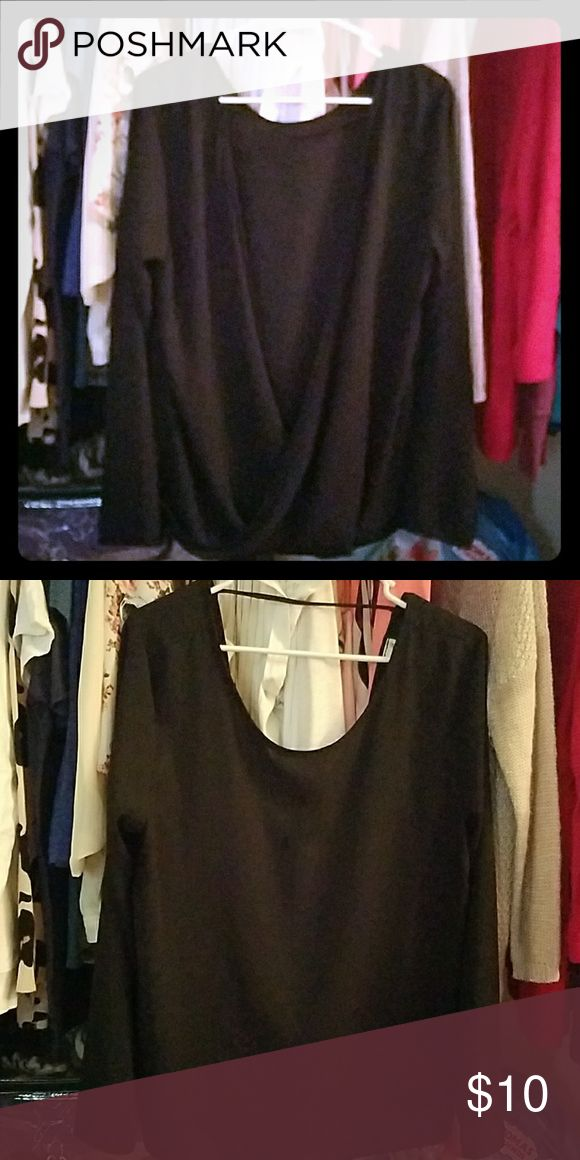 Black dressy casual top Cute, black, neckline blouse with an open back. Cute for dressy casual date nights or a night out with the girls. Only worn once Paper Crane Tops Blouses