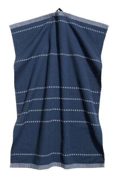 Serviette: Serviette en coton tissé avec coutures décoratives. Dos en coton éponge. Patte de suspension sur une largeur.