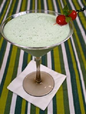 The Naughty Leprechaun   (2 cups vanilla ice cream  1/4 cup Bailey's Original Irish Cream  1/4 cup Creme de Menthe  1/2 cup milk  Garnish:  Mint sprigs  Red or green maraschino cherries)