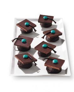 Graduation Party Food: Tasseled Treats  Cap off your graduation party with a tray of these bite-size mortarboard cakes.