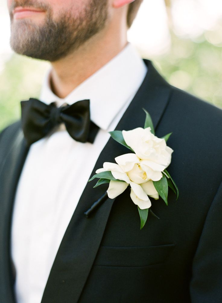 Magnolia boutonniere and a crisp black tux for the groom - Perfection! ~ we ❤ this! moncheribridals.com