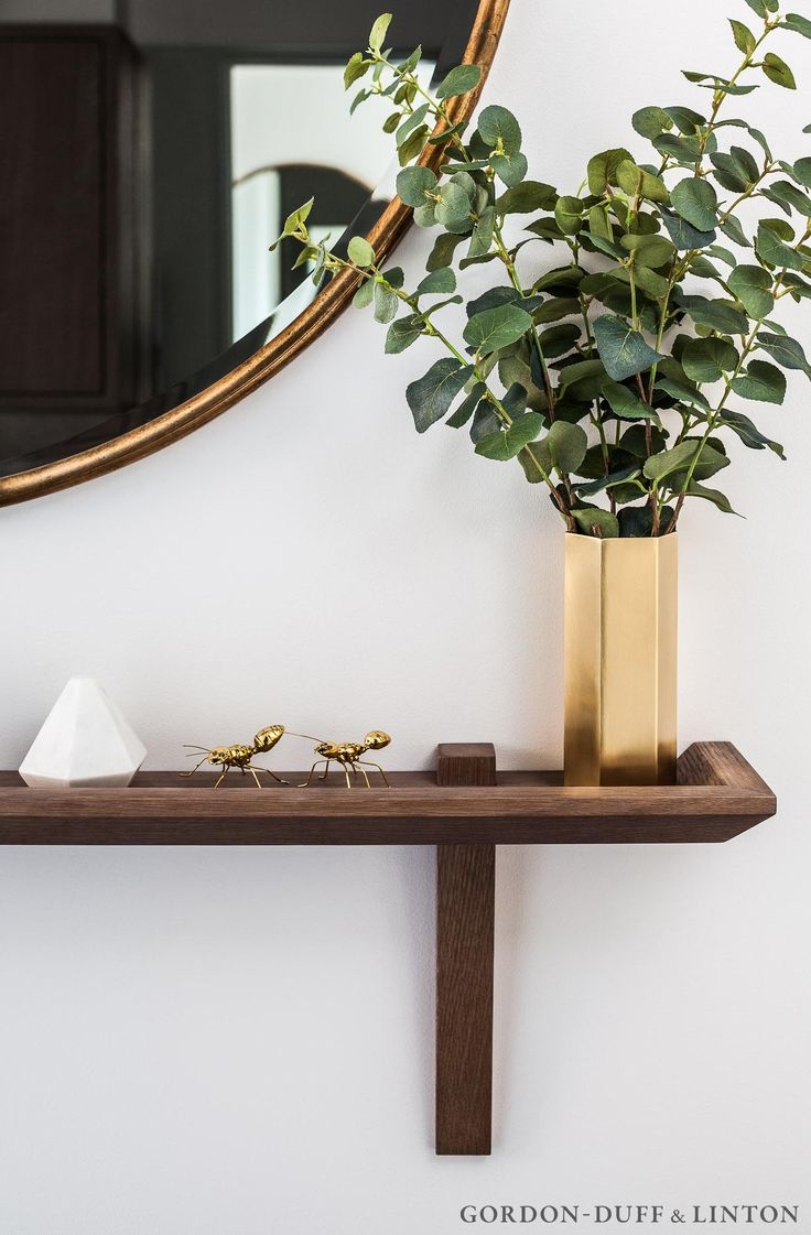 Detail of bespoke wooden shelf in hallway with brass ants and hexagonal brass vase. #GD&LBespoke