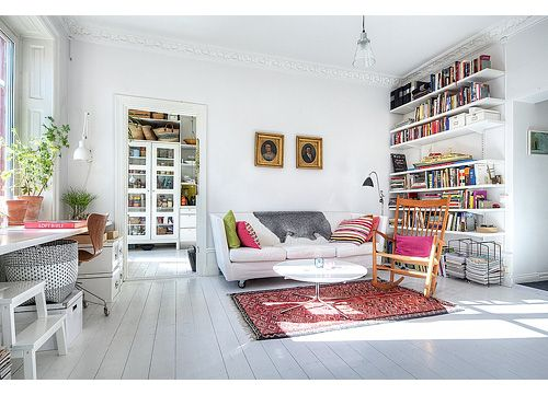 Wall of Books+ white sofa and wood floors= peaceful relaxation.