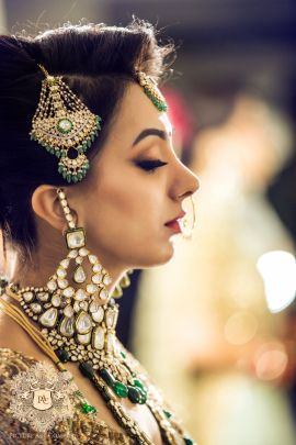Indian Wedding Jewelry - Jai & Nayana wedding story | WedMeGood | Polki Jewelry with Emerald and Kundan Jhoomar #wedmegood #indianbride #indianwedding #bridal #polki #emeralds #indianweddingjewelry #weddingjewelry