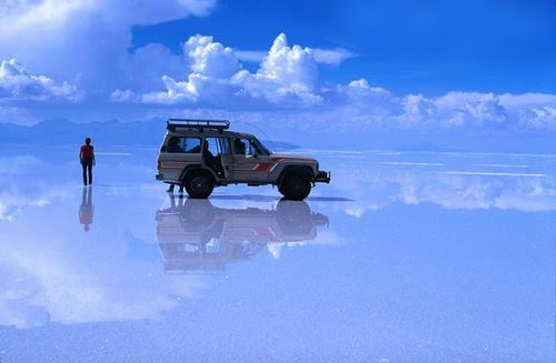 The world's largest salt flat in Bolivia. When wet, it looks like heaven on earth. :)