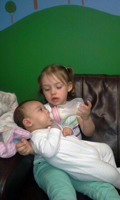 Kenzie feeding her cousin