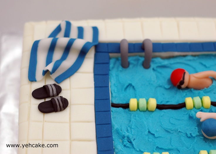 Details of swimming pool cake - slippers, towel, swimmers all made from sugar paste.