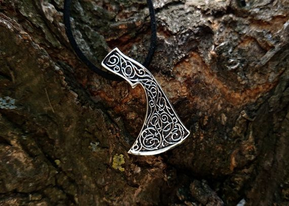 Axe of Perun gives victory in all matters fair, gives courage and confidence, clears the owner of a talisman of wickedness and evil eyes, bestows prosperity and fertility.