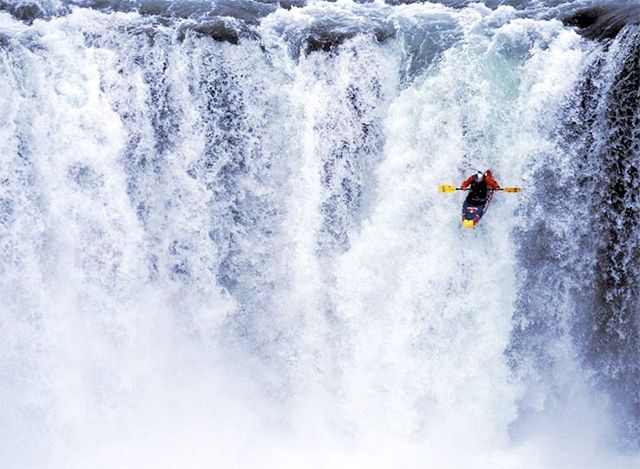 Although I would never attempt this, I do enjoy kayaking in the pacific ocean with tiger sharks swimming below me.
