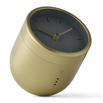 Menu  Menu Tumbler Alarm Clock - Brushed Brass: An updated version of the traditional alarm clock design, Norm's round-faced clock sits atop a round bottomed brushed brass base and must be turned over and positioned face down in order to silence the alarm.