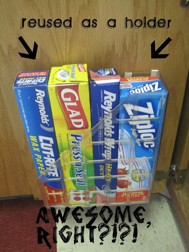 Store rolled paper products in a vertical paper file bin, attached to the back of a cupboard.