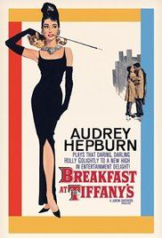 BREAKFAST AT TIFFANY'S (Audrey Hepburn, George Peppard, Patricia Neal, 1961.) A young New York socialite becomes interested in a young man who has moved into her apartment building.