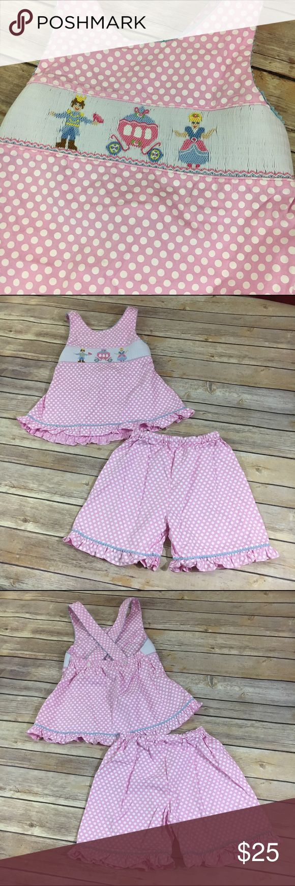 Claire & Charlie Outfit Carriage Prince & Princess Claire & Charlie Outfit Carriage Prince & Princess 6  Super cute criss cross back straps top with elastic in back.  Straps button on.  Smocked in front with a prince, princess & carriage.  Shorts have an elastic waist and ruffles.  Very good used condition.  #polkadot #polkadots #prince #princess #carriage #smocked #smocking #pink #white #outfit #set #ruffles Claire & Charlie Matching Sets